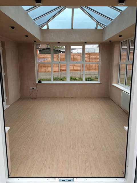 Conservatory floor tiled with Rondine Jungle Daintree wood effect tiles from CTD